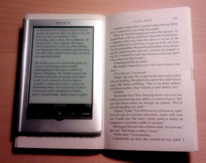 Sony Pocket Edition next to a paperback